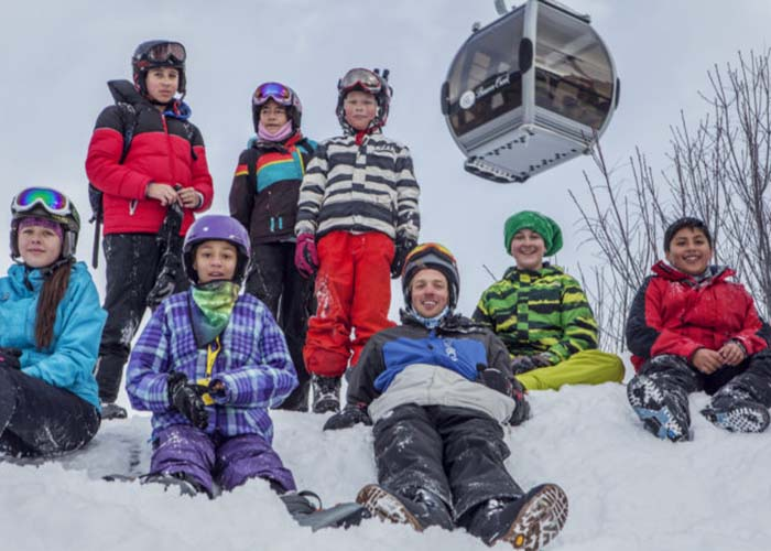 SOS Outreach youth on the mountain in winter gear