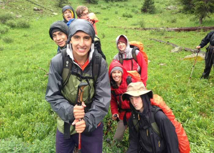 SOS Outreach on a hike through a rainy forest