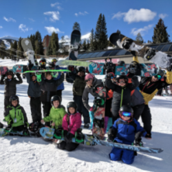 SOS Outreach Youth with their snowboards outside