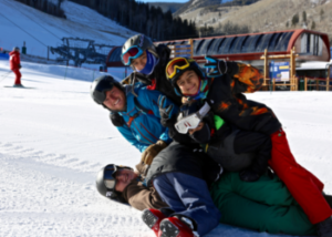 Mentors and SOS Outreach Youth playing on the ski mountain